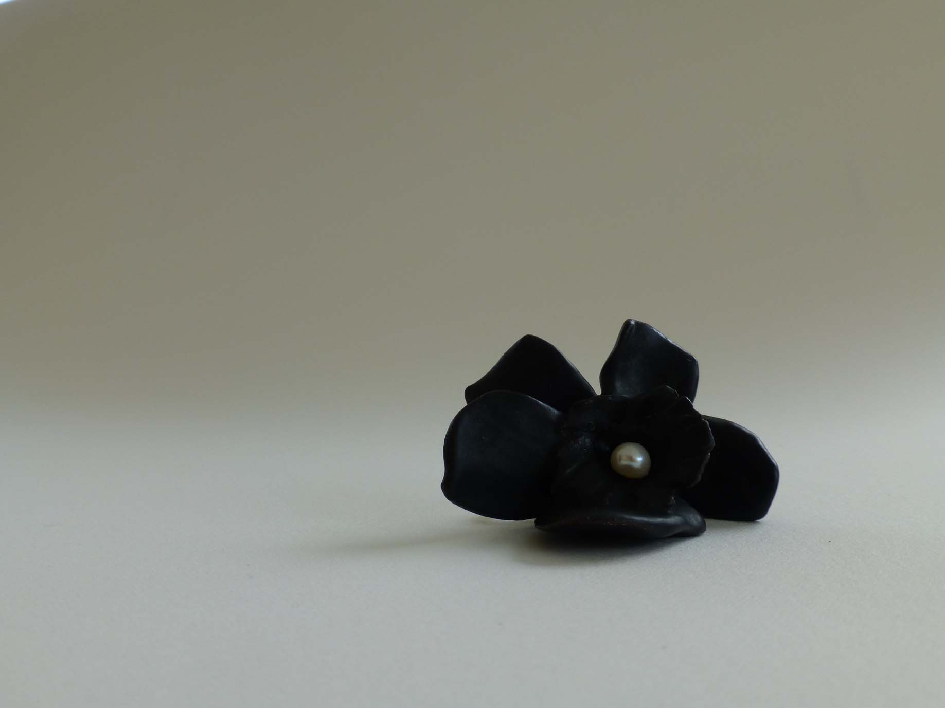 black baby brooch